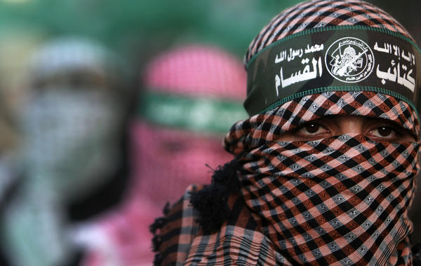 Members of the Ezzedine al-Qassam brigades, the armed wing of Hamas, march during a rally in Gaza City on December 2, 2012, as celebrations begin to mark the 25th anniversary of its foundation.