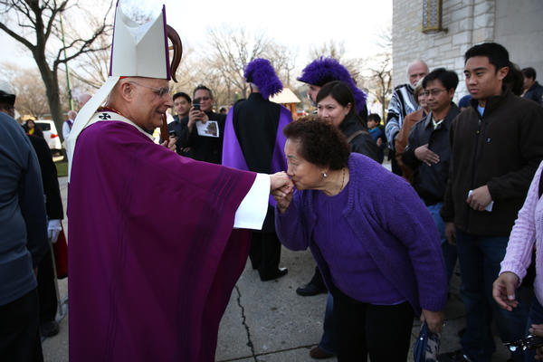Cardinal Francis George greets parishoners after celebrating mass at the Queen of All Saints Basilica in Chicago Sunday. The church was celebrating it's 50th anniversary of being named as a basilica.