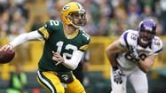GREEN BAY, Wis. -- Aaron Rodgers got plenty of help. Adrian Peterson got none at all.