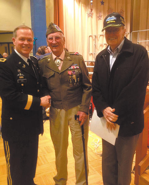 From left, Maj. Gen. Butch Tate, deputy judge advocate general of the U.S. Army; World War II veteran Lester Hart; and retired Col. Clyde Tate were honored by students and staff at a Veterans Day ceremony at Hickory Elementary School.