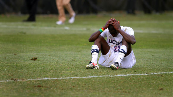 UConn forward Mamadou Doudou Diouf sits on the field after losing to Creighton with 90 seconds to go in the game.