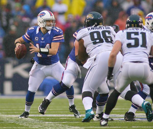 Ryan Fitzpatrick (L) readies to pass against the Jacksonville Jaguars at Ralph Wilson Stadium in December.
