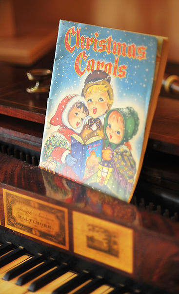 A vintage booklet of Christmas songs at the Miller House Museum sits on an antique piano made in Baltimore.