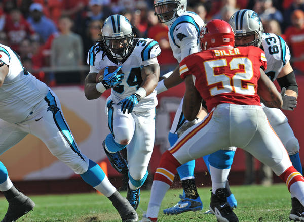 Running back DeAngelo Williams #34 of the Carolina Panthers rushes up field against the Kansas City Chiefs during the first half on December 2, 2012 at Arrowhead Stadium in Kansas City, Missouri. Kansas City defeated Carolina 27–21.