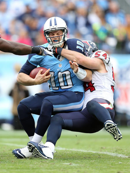 Jake Locker #10 of the Tennessee Titans is sacked by Barrett Rudd #54 of the Houston Texans during the game at LP Field on December 2, 2012 in Nashville, Tennessee. Houston won 24–10.