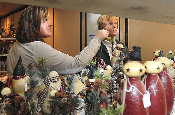 Deanna Reed, left, and her mother, Charlene Reed, browse Sunday during the Christmas Shopping Extravaganza at Hager Hall Conference and Event Center.