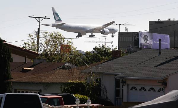 In a view from Kittyhawk Ave. in Westchester, a plane heads to the north runway at LAX.