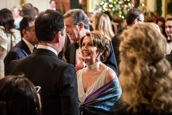 Comic talk-show host Jimmy Kimmel greets House Minority Leader Nancy Pelosi at the Kennedy Center Honors reception.