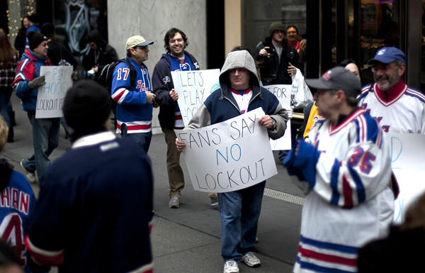 Hockey fans hold a protest outside the NHL offices in New York.