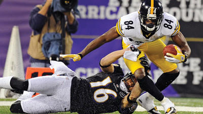 The Baltimore Ravens¿ David Reed tries to tackle Pittsburgh Steelers wide receiver Antonio Brown during the first half on Sunday in Baltimore.