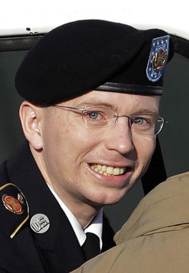 In a Wednesday, Nov. 28 file photo, Army Pfc. Bradley Manning, center, steps out of a security vehicle as he is escorted into a courthouse in Fort Meade, Md., for a pretrial hearing. Manning is charged with aiding the enemy by causing hundreds of thousands of classified documents to be published on the secret-sharing website WikiLeaks. He acknowledged in pretrial testimony on Friday, Nov. 30 that he tied a bedsheet into a noose and contemplated suicide after he was first arrested. His testimony appeared to support the military's argument that it was trying to protect Pfc. Bradley Manning from himself by keeping him under strict isolation. Manning's defense team argues the conditions he experienced for nine months at the Marine Corps brig in Quantico, Va., were too harsh, well past the time he was still having suicidal thoughts, and his charges should be dropped because of it.