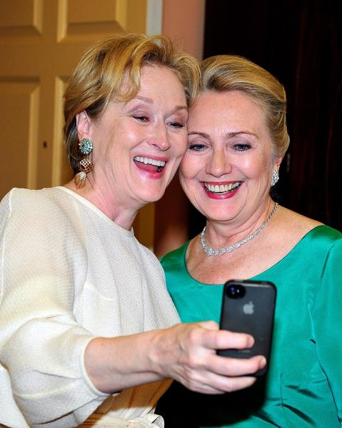 Meryl Streep, left, takes a photo of herself with Secretary of State Hillary Rodham Clinton.