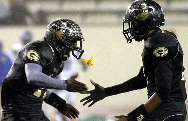 Narbonne wide receiver A.J. Richardson is congratulated by teammate Josh Collins after making a touchdown catch against Crenshaw in the fourth quarter of the City Section Division I championship game Saturday at East Los Angeles College.