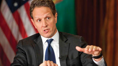 "This Nov. 30, 2012, photo provided by CBS News shows Treasury Secretary Timothy Geithner answering questions about averting the ""fiscal cliff"" on the December 2nd edition of ""Face the Nation."" Geithner said Republicans have to stop using fuzzy ""political math"" and say how much they are willing to raise tax rates on the wealthiest 2 percent of Americans and then specify the spending cuts they want, Treasury Secretary."