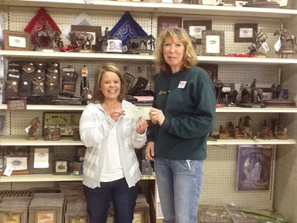 Karla Whiting, right, of the Runnings store in Aberdeen presents a check for $400 to Angie Saponiac of the American Cancer Society. The funds were raised during Ladies Night on Oct. 24.