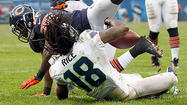As shaken Seahawks wide receiver Sidney Rice lay flat on his back in the end zone after scoring the winning touchdown Sunday in Seattle's 23-17 overtime victory over the Bears, fans gave him a warped welcome to the southeast corner of Soldier Field.