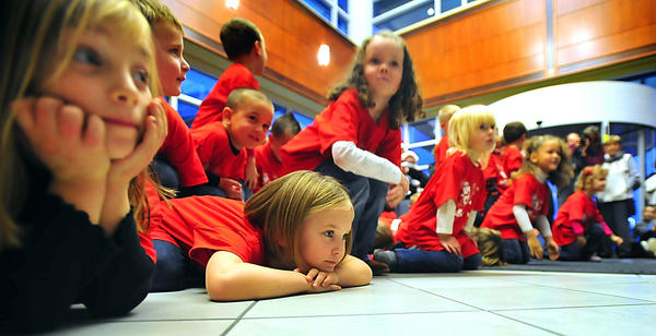 Josie Dominick, from left, Emmalyn Nunes, Ava Lucas and other students from the 4- and 5-year- old class at Meritus Health's The Learning Center finish a performance of The Little Snowman Sunday evening by flopping on the floor. The hospital held the 28th annual Tree of Lights ceremony.
