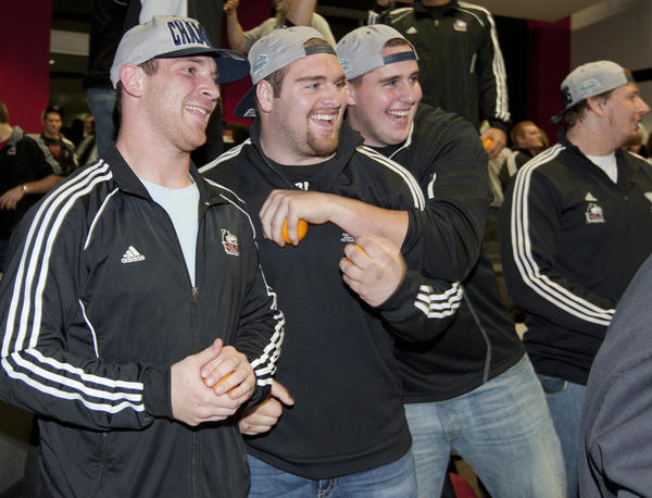 NIU quarterback Jordan Lynch, along with Jared Volk and Ryan Brown celebrate on Sunday.