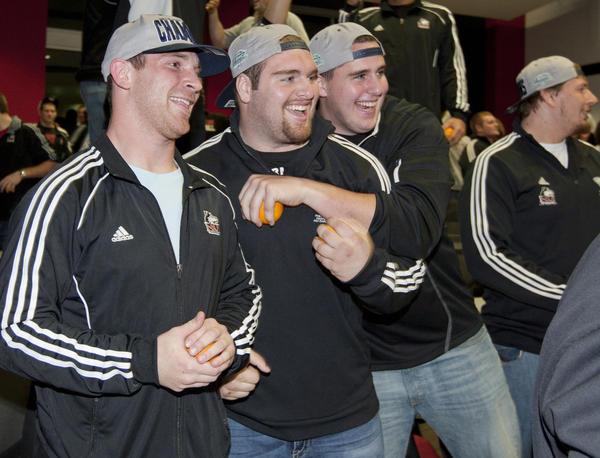 NIU quarterback Jordan Lynch, along with Jared Volk and Ryan Brown celebrate on Sunday.