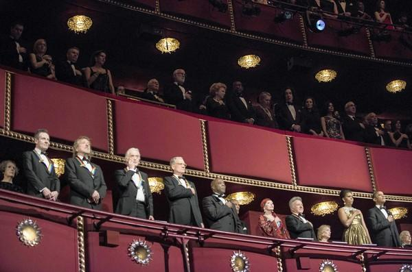 The Kennedy Center Honorees, from left, John Paul Jones, Robert Plant and Jimmy Page of Led Zeppelin, talk show host David Letterman, blues musician Buddy ballerina Natalia Makarova and actor Dustin Hoffman, First Lady Michelle Obama and President Obama listen to the national anthem during the 2012 Kennedy Center Honors at the Kennedy Center on Dec. 2, 2012, in Washington, DC.