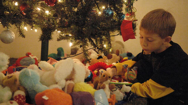 William Owen Wright, 7, picks out a stuffed animal that sits under the Christmas tree at the Women's Auxiliary Children's Christmas party that  took place at the American Legion in El Centro on Sunday afternoon.