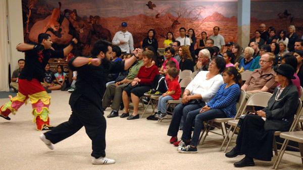 Chinese martial arts fighters perform at the Holiday Tour around the World at Pioneers Museum in Imperial on Saturday evening.
