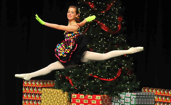 "Laura Clement flies gracefully across the stage in the dance of the Merlitons during Sunday's performance of excerpts from ""The Nutcracker"" performed by dancers from A&B Dance Dimensions and A&B Dance Company of Waynesboro, Pa., at Waynesboro Area Senior High School. About 70 young dancers participated in the presentation, which also was performed Saturday night."