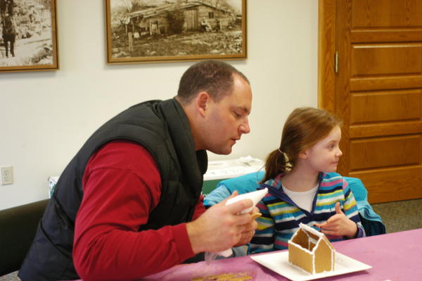Ella Seelye spent some quality time with her father, Stephen, Saturday, Dec. 1, during a gingerbread house construction project sponsored by Boyne District Library in Boyne City.