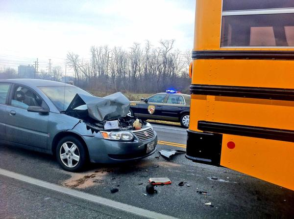A Saturn sedan, left, was damaged when it crashed into a Washington County Public Schools bus carrying students to Pangborn Elementary School on Monday morning, authorities said. No one was injured.