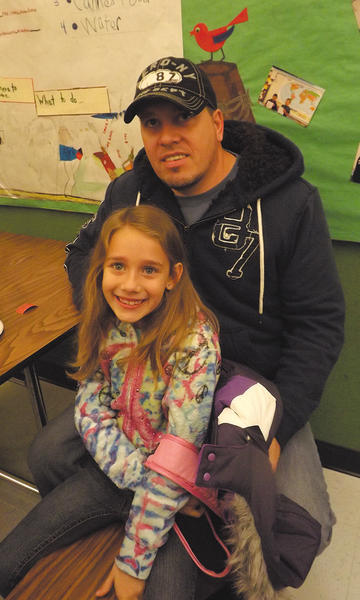 Laney Damewood is shown with Daniel Damewood at Hancock Elementary School's Dads and Donuts event.