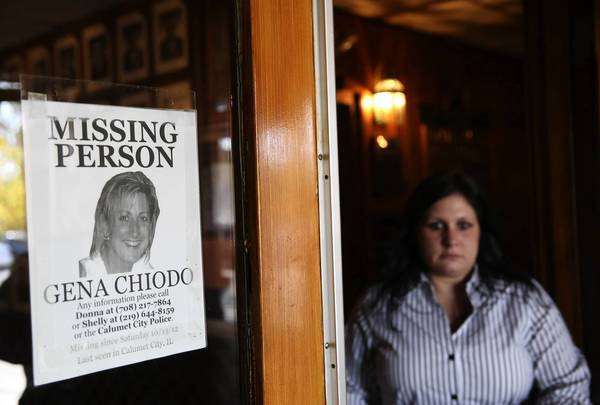A missing person flier for Gena Chiodo is posted at the entrance of the Columbian Club in Lansing, Indiana in October.