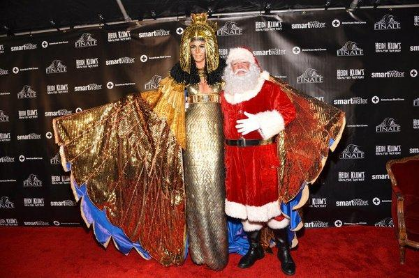 Supermodel Heidi Klum poses with Santa at her Halloween party in December.