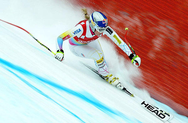 U.S. skier Lindsey Vonn streaks downhill in the women's Alpine Skiing World Cup in Alberta, Canada on Dec. 1. Vonn won the ladies downhill event with another American, Stacey Cook, taking second.