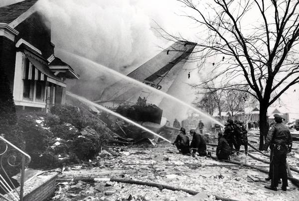 Firefighters work at the scene where United Airlines Flight 553 crashed into a row of bungalows on West 70th Place while approaching Midway Airport in Chicago.