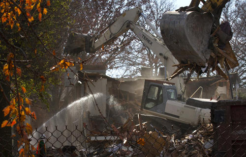 Excavators continue to demolish section after section of Harbor Square Apartments in downtown Hampton with debris being hauled from the site by the tractor trailer load  as shown here on Monday, December 3, 2012.