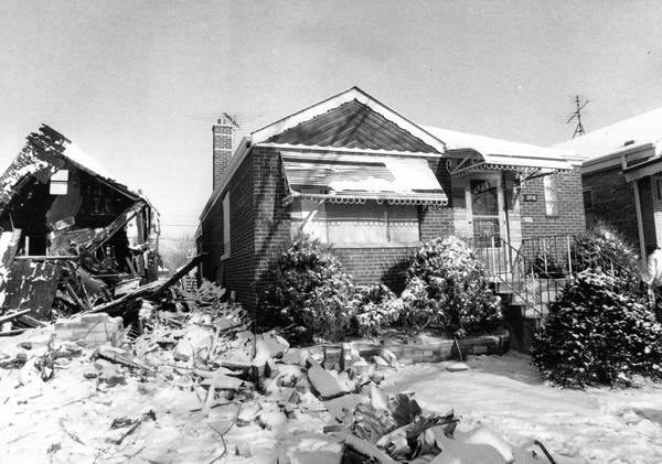 The home of Joseph Tworzydlos, 3716 W. 70th Pl., seen on Dec. 10, 1972, sits next to where the United Airlines Flight 553 crashed two days before while approaching Midway Airport. The Tworzydlos were the only family to remain in their damaged home.