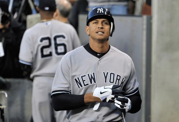New York Yankees' Alex Rodriguez reacts after returning to the dugout after his first at-bat in the sixth inning during Game 4 of the MLB ALCS baseball playoff series against the Detroit Tigers in Detroit, Michigan, October 18, 2012.