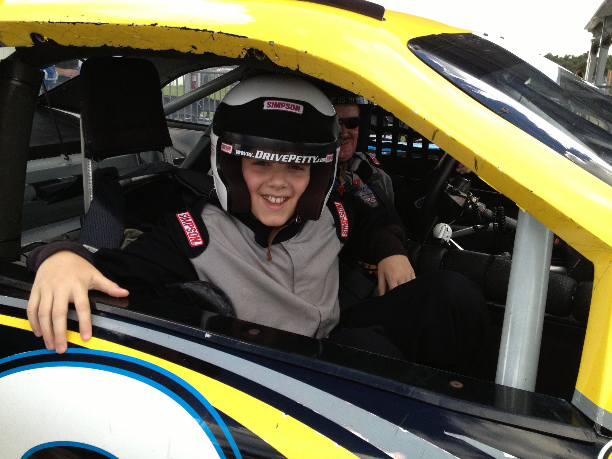 Ian Laviolette, 12, of Cooper City, rides in a car during the Junior Ride-Along at the Ricard Petty Driving Experience at Walt Disney World Speedway.