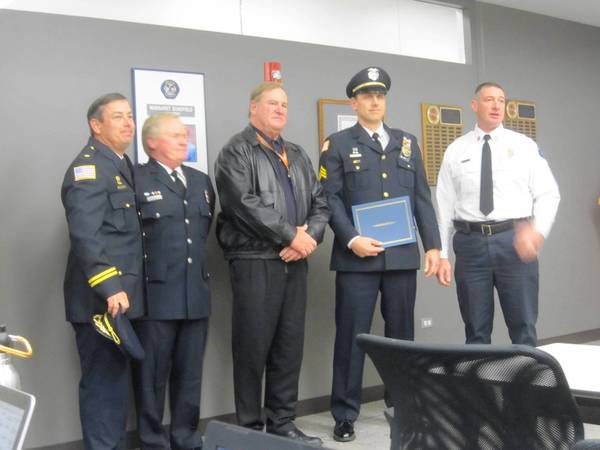 Orland Fire Protection District Chief Ken Brucki (right) recognizes Orland Police Officer Troy Siewert for his life-saving actions. Orland Police Chief Tim McCarthy (center, Fire Lt. Mark Duke, and Police Cmdr. Tom Kenealy.