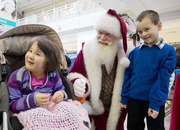 "Twins Sydney and Logan Marko, 7, of Mountain Top, Luzerene County, visit with Santa during ""Caring Santa"" on Sunday. Sydney has an undiagnosed disease. The Lehigh Valley Mall opened an hour early to hold the event for families that have children with special needs, and provided a subdued environment to visit The Santa Photo Experience. Caring Santa has been developed by Simon Property Group, Inc. and is guided by AbilityPath.org, a national online resource hub and special needs community. /// Dec. 2, 2012 Harry Fisher / THE MORNING CALL MC-SANTA-SPECIAL-NEEDS"