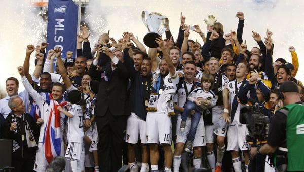 Members of the Galaxy celebrate their MLS championship.