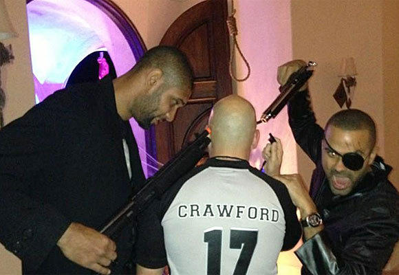 San Antonio Spurs' Tim Duncan, left, and Tony Parker, right, might have stirred up some trouble by posing for this photo with fake guns at a Halloween party.