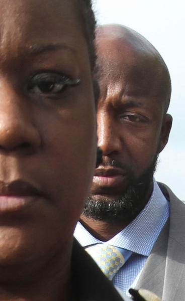 Looking  very concerned Tracy Martin, right, Sybrina Fulton, left , parents of Trayvon Martin who was killed arrive Friday, April 20, 2012 for the bond hearing of George Zimmerman at the Seminole County courthouse.