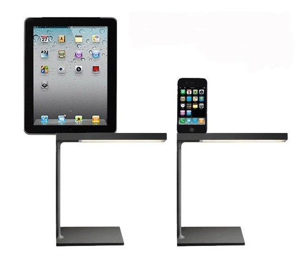 "The Italian lighting firm Flos has puts its black D'E-light desk lamp on sale at 50% off through Dec. 31. The design, by Philippe Starck, has a backrest and USB socket to charge an iPad, iPhone or iPad. The touch-sensitive LEDs can change intensity from 100% to 50% to off with one finger. Regularly $395, the black lamp is on sale for $199. The design also comes in chrome, but only the black matte finish is on sale, through the Flos showroom in L.A. (part of the <a href=""http://www.divafurniture.com/flash/index.html"">Diva Group</a>) or <a href=""http://www.flosusa.com/individualProduct.php?prodID=428&type=&cat_name=Table&name=D%27E-LIGHT&seriesID=504&color_id=&model_id="">online</a>. 