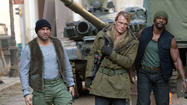 "Randy Couture, Dolph Lundgren and Terry Crews in ""The Expendables 2."""