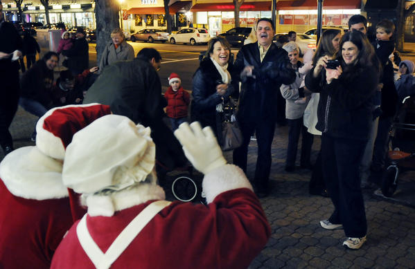 Santa and Mrs. Claus, played by Norman Ward of Portland and Dianne Grenier of Andover, welcomed children near the Toy Chest on Farmington Avenue during the 2011 Holiday Stroll.