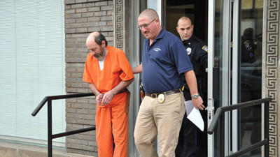 Lester Gindlesperger escorted to jail