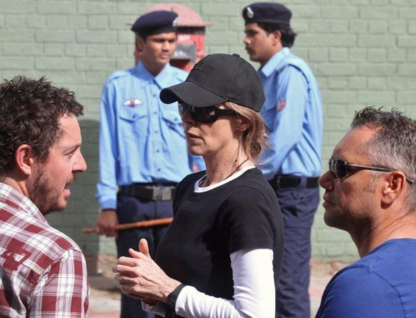 "Oscar-winning director Kathryn Bigelow (C) stands during a shoot at the filming location of the movie ""Zero Dark Thirty"" in the northern Indian city of Chandigarh March 17, 2012."