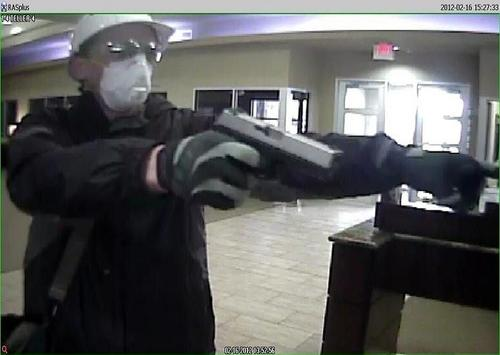 These images from a National Bank of Texas branch in Azle, Texas show a man resembling Keyes robbing the bank in less than two minutes on Feb. 16. Keyes was never charged in relation to the robbery.