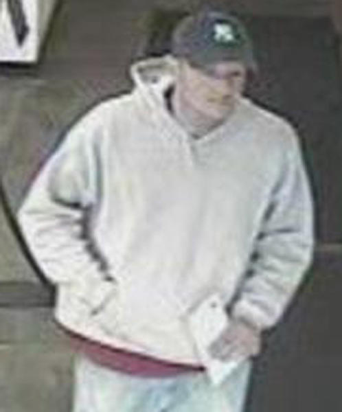 A surveillance photo from a bank robbery today in Glenview.